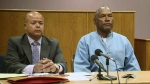 Former NFL football star O.J. Simpson appears with his attorney for his parole hearing at the Lovelock Correctional Center in Lovelock, Nev., on Thursday, July 20, 2017. (Lovelock Correctional Center via AP)