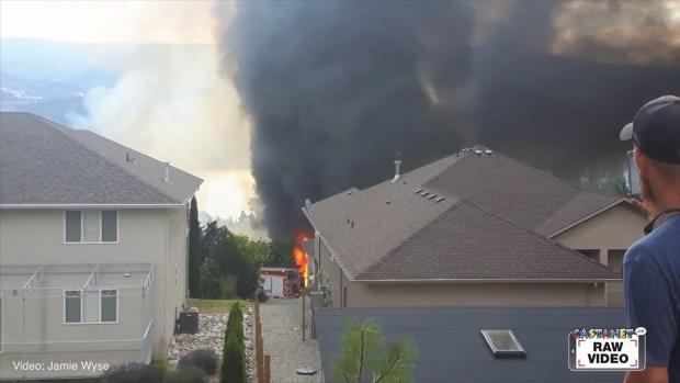 Firefighters battle a blaze in the West Bench area outside Penticton, B.C. July 20, 2017. (Jamie Wyse/Castanet)
