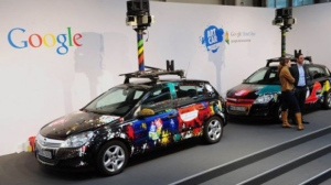 Cars equipped with special cameras, used to photograph whole streets, can be seen on the Google street view stand at the world's biggest high-tech fair, the CeBIT on March 3, 2010 in the northern German city of Hanover. DANIEL MIHAILESCU / AFP
