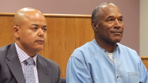 Former NFL football star O.J. Simpson appears with his attorney, Malcolm LaVergne, left, via video for his parole hearing at the Lovelock Correctional Center in Lovelock, Nev., on Thursday, July 20, 2017. Simpson was convicted in 2008 of enlisting some men he barely knew, including two who had guns, to retrieve from two sports collectibles sellers some items that Simpson said were stolen from him a decade earlier. (Jason Bean/The Reno Gazette-Journal via AP, Pool)