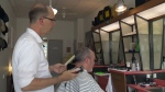 Matthew Forbes prepares to cut a customer's hair at Matthew's Barbershop in Guelph.