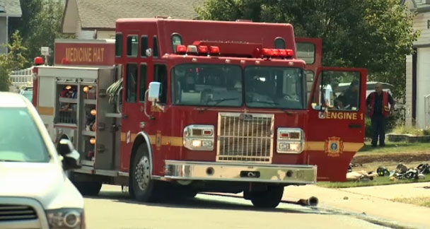 A Medicine Hat Fire Service engine outside of a home on Hudson Way NE following Wednesday's explosion and fire