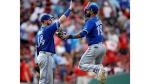 Toronto Blue Jays right fielder Jose Bautista (19) leaps as he celebrates with first baseman Justin Smoak (14) after defeating the Boston Red Sox 8-6 in a baseball game at Fenway Park in Boston, Thursday, July 20, 2017. Smoak had two home runs in the win. (AP Photo/Charles Krupa)