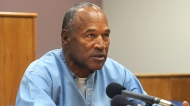 Former NFL football star O.J. Simpson appears via video for his parole hearing at the Lovelock Correctional Center in Lovelock, Nev., on Thursday, July 20, 2017. Simpson was granted parole Thursday after more than eight years in prison for a Las Vegas hotel heist, successfully making his case in a nationally televised hearing that reflected America's enduring fascination with the former football star. (Jason Bean/The Reno Gazette-Journal via AP, Pool)