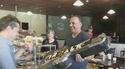 Business owner helps return guitar