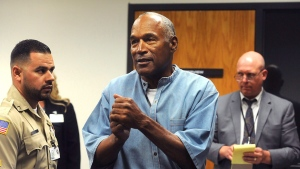 Former NFL football star O.J. Simpson reacts after learning he was granted parole at Lovelock Correctional Center in Lovelock, Nev., on Thursday, July 20, 2017. Simpson was convicted in 2008 of enlisting some men he barely knew, including two who had guns, to retrieve from two sports collectibles sellers some items that Simpson said were stolen from him a decade earlier. THE CANADIAN PRESS / AP-Jason Bean, The Reno Gazette-Journal - POOL