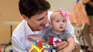 Prime Minister Justin Trudeau takes a photo with young Emma McDonald at the Barrie Community Centre in Barrie, Ont. on Thursday, July 20, 2017. (THE CANADIAN PRESS/Fred Thornhill)