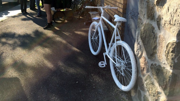 This ghost bike was installed Friday July 21, 2017 at the corner of Belanger St. and 6th Ave. to mark the death of Meryem Anoun, who was killed when a truck made a righthand turn. (CTV Montreal/Derek Conlon)