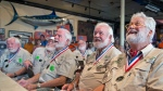 In this photo provided by the Florida Keys News Bureau, Wally Collins, right, and other past winners of the Hemingway Look-Alike Contest closely examine entrants in the 2017 contest Thursday, July 20, 2017, at Sloppy Joe's Bar in Key West, Fla. Some 160 contestants are registered for this year's competition that is part of Key West's annual Hemingway Days festival. Another preliminary round is scheduled for Friday, July 21, and the finals are set for Saturday, July 22. Author Ernest Hemingway lived in Key West in the 1930s. (Andy Newman/Florida Keys News Bureau via AP)