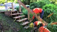 City crews work to dismantle a thrifty set of stairs made by a local resident.