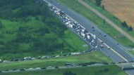 Cars were backed up for several hours on Highway 400 after a chemical spill prompted lengthy road closures.