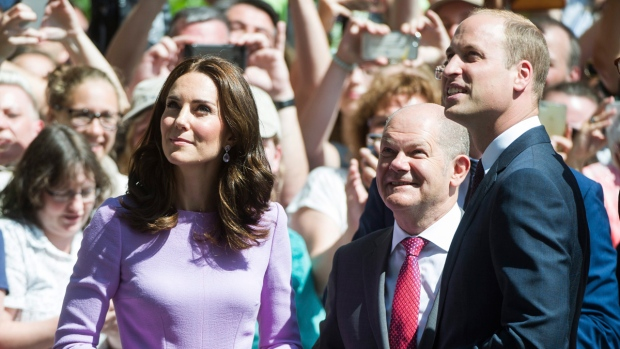 Prince William, right, and Kate the Duchess of Cambridge, left, arrive to the Elbphilharmonie while Hamburg's First Mayor Olaf Scholz, centre, stands next to them in Hamburg, Germany, on July 21, 2017. (Christina Sabrowsky / dpa via AP)