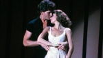 Patrick Swayze, portraying Johnny Castle, and Jennifer Grey, portraying Baby Houseman, in a scene from the film, 'Dirty Dancing.' (Lionsgate Home Entertainment / AP)