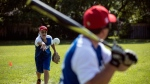 Toronto Blind Jays general manager, coach and pitcher Arthur Pressick (left) calls out as he throws the ball to a batter during a practice session in Toronto on Tuesday July 18, 2017. (THE CANADIAN PRESS/Chris Young)