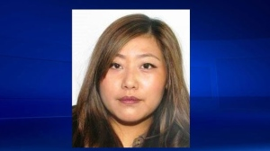 Woman sought in quadruple murder