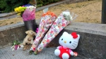 Flowers and stuffed animals are laid in tribute in Central Park to 13-year-old Marrisa Shen. (Ben Miljure)