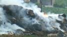 2 men seen before building bursts into flames