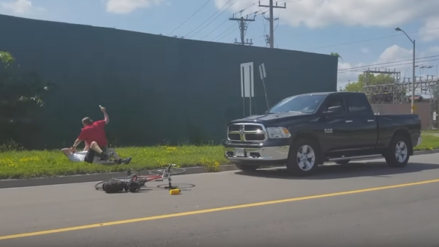 Image from YouTube video of a 65-year-old pickup truck driver repeatedly hitting elderly cyclist with a small club. (Lance Anderson/YouTube)