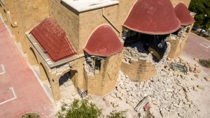 Damage is seen at a Greek Orthodox church after an earthquake on the island of Kos, Greece Friday, July 21, 2017. A powerful earthquake sent a building crashing down on tourists at a bar on the Greek holiday island of Kos and struck panic on the nearby shores of Turkey early Friday, killing two people and injuring some 200 people. (Nikiforos Pittaras / AP)