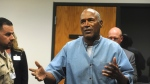 Former NFL football star O.J. Simpson reacts after learning he was granted parole on Thursday, July 20, 2017. (Jason Bean/The Reno Gazette-Journal via AP, Pool)