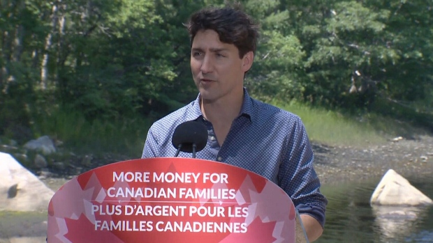 Prime Minister Justin Trudeau speaks to media at a summer camp in Shelburne, N.S. on July 21, 2017.