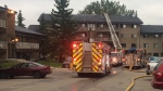 Firefighters on the scene of an apartment fire on 177 Street and 64 Avenue on Friday, July 21, 2017.