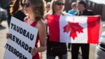 Protesters at an event in Mississauga, Ont., attended by Prime Minister Justin Trudeau on July 20, 2017. (Mark Blinch /THE CANADIAN PRESS)