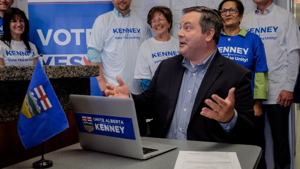 Alberta PC Leader Jason Kenney, centre, reacts after casting his ballot in the PC Referendum on Unity at his campaign office in Calgary, Alta., Thursday, July 20, 2017. (THE CANADIAN PRESS/Jeff McIntosh)