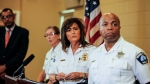 Minneapolis police chief Janee Harteau, center, stands with police inspector Kathy Waite, left, and assistant chief Medaria Arradondo during a news conference Thursday, July 20, 2017, Minneapolis. (Maria Alejandra Cardona/Minnesota Public Radio via AP)