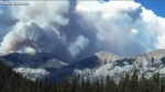 Smoke from the Verdant Creek wildfire appears in a photograph released on July 22, 2017  (Parks Canada)