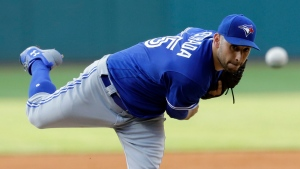 Toronto Blue Jays starting pitcher Marco Estrada delivers during the first inning of the team's baseball game against the Cleveland Indians, Friday, July 21, 2017, in Cleveland. (AP Photo/Tony Dejak)