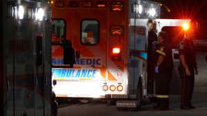 Paramedics are shown outside a Mississauga fire hall, where two stabbing victims reportedly showed up in search of assistance on Saturday morning. (Pascal Marchand)