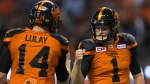 B.C. Lions' Ty Long, right, and quarterback Travis Lulay celebrate after Long kicked what proved to be the winning field goal against the Winnipeg Blue Bombers during the second half of a CFL football game in Vancouver, B.C., on Friday July 21, 2017. (THE CANADIAN PRESS/Darryl Dyck)