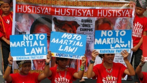 Protesters march towards the Lower House to coincide with the special joint session on the possible extension of martial law in the southern Philippines, Saturday, July 22, 2017 in Quezon city northeast of Manila, Philippines. (AP Photo/Bullit Marquez)
