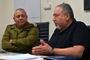 This handout photo provided by the Israeli military on Saturday, July 22, 2017, shows Israel's defense minister, Avigdor Lieberman talking to army chief Lt. Gen. Gadi Eizenkot at an Israeli military base in the West Bank. Israel has sent more troops to the West Bank.. (Israeli military via AP)