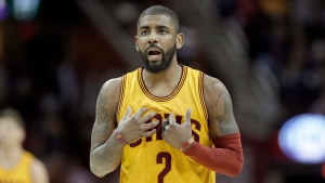 In this Feb. 27, 2017, file photo, Cleveland Cavaliers' Kyrie Irving talks with a teammate in the first half of an NBA basketball game against the Milwaukee Bucks in Cleveland. (AP Photo/Tony Dejak, File)