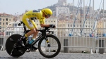 Britain's Chris Froome, wearing the overall leader's yellow jersey, competes in the twentieth stage of the Tour de France cycling race, an individual time trial over 22.5 kilometers (14 miles) with start and finish in Marseille, southern France, Saturday, July 22, 2017. (AP Photo/Claude Paris)