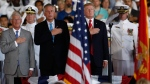 From left, Sen. Roger Wicker, R-Miss., Virginia Gov. Terry McAuliffe and President Donald Trump stand for the presentation of the colors during the commissioning ceremony of the aircraft carrier USS Gerald R. Ford (CVN 78) at Naval Station Norfolk, Va., Saturday, July, 22, 2017. (AP Photo/Carolyn Kaster)