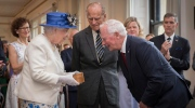 Britain's Queen Elizabeth II talks with Canada Governor General David Johnston at Canada House in Trafalgar Square, central London, Wednesday July 19, 2017, marking the 150th anniversary of Canada's Confederation. The queen will meet various dignitaries and guests during her visit to celebrate the establishment of modern Canada 150-years ago. (Stefan Rousseau/PA via AP)