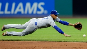 Toronto Blue Jays' Ryan Goins dives unsuccessfully for a single by Cleveland Indians' Giovanny Urshela in the fifth inning of a baseball game, Saturday, July 22, 2017, in Cleveland. (AP Photo / Tony Dejak)