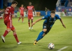 Montreal Impact's Blerim Dzemaili chases the ball as FC Dallas' Ryan Hollingshead looks on during second half MLS action in Montreal on Saturday, July 22, 2017. (Peter McCabe/ The Canadian Press)
