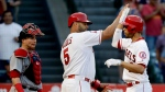 Los Angeles Angels' Andrelton Simmons, right, celebrates his two-run home run with Albert Pujols as Boston Red Sox catcher Christian Vazquez looks on during the third inning of a baseball game in Anaheim, Calif., Saturday, July 22, 2017. (AP / Chris Carlson)