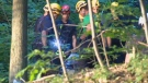 Firefighters work to bring a man's body down from Mount Royal after a fatal fall.