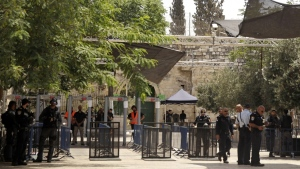 Israeli border police officers stand near newly installed cameras at the entrance to the Al Aqsa Mosque compound, in Jerusalem's Old City, Sunday, July 23, 2017. (AP Photo/Mahmoud Illean)