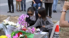 Friends and neighbours gathered to remember and honour Marrisa Shen at a vigil in Burnaby on Saturday, July 22, 2017. (CTV)