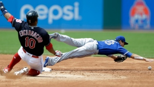 Toronto Blue Jays' Darwin Barney, right, reaches for the ball but not in time to get Cleveland Indians' Edwin Encarnacion (10) out at second base in the third inning of a baseball game, Sunday, July 23, 2017, in Cleveland. Encarnacion was safe at second on a throwing error by third baseman Josh Donaldson. (AP Photo/Tony Dejak)