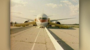 Captain Bob Pearson was forced to land the plane with no engine power on a decommissioned runway that had been converted from an air force base to a motor racing track, now known as Gimli Motorsports Park. (Source: CTV Archives)