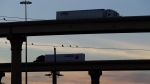 In this Nov. 21, 2016 file photo, trucks travel on an overpassed to and from the World Trade Bridge, in Laredo, Texas. (AP Photo/Eric Gay, File)