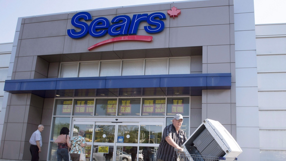 Bargain hunters are seen at the Sears store Friday, July 21, 2017 in St. Eustache, Quebec. THE CANADIAN PRESS/Ryan Remiorz