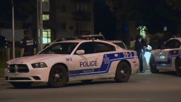 Montreal police outside a Langelier Blvd. apartment where a pregnant woman was stabbed multiple times on July 24, 2017 (CTV Montreal)